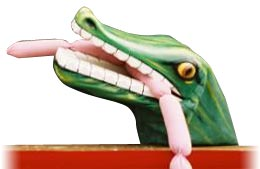 Punch &Judy crocodile with sausages in its mouth.